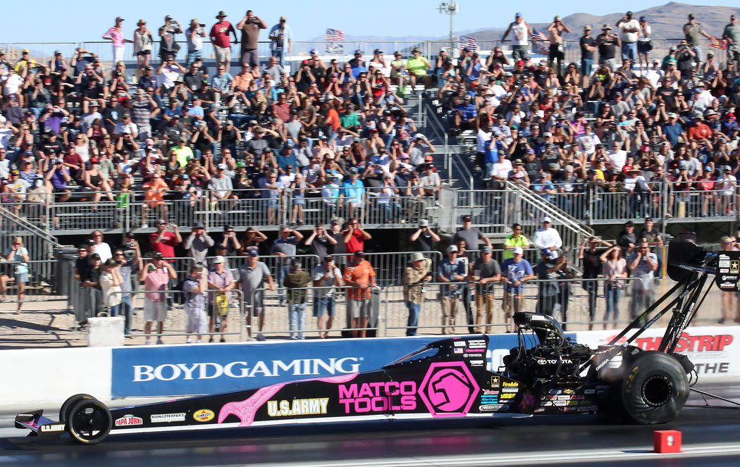 NHRA Top Fuel dragster driver Antron Brown makes a pass during the third round of qualifying race for the Mello Yello NHRA Toyota Nationals at The Strip at Las Vegas Motor Speedway on Saturday, Oc ...