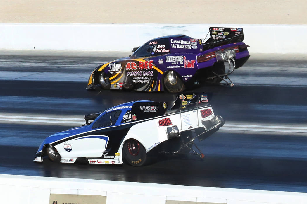 NHRA Funny Car drivers Gary Densham, left, and Bob Bode race during the third round of qualifying race for the Mello Yello NHRA Toyota Nationals at The Strip at Las Vegas Motor Speedway on Saturda ...