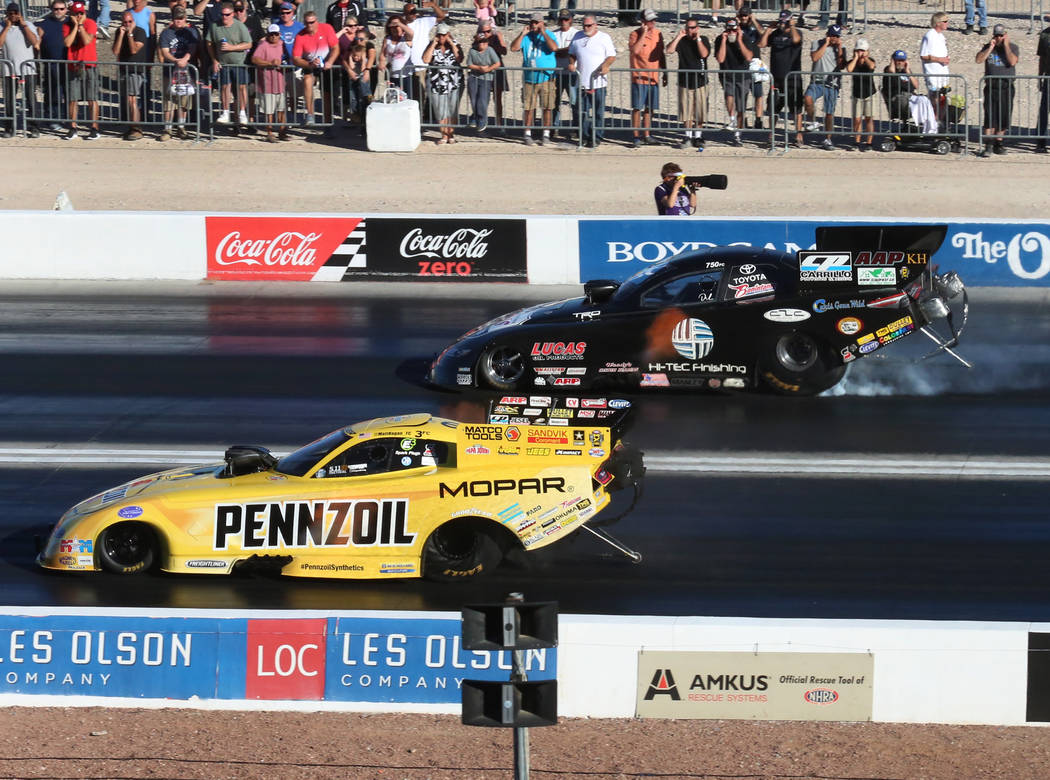 NHRA Funny Car drivers Matt Hagan, left, and Del Worsham race during the third round of qualifying race for the Mello Yello NHRA Toyota Nationals at The Strip at Las Vegas Motor Speedway on Saturd ...