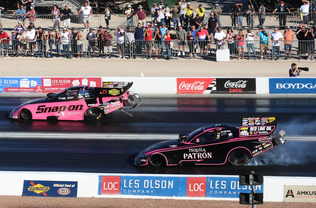 NHRA Funny Car drivers Cruz Pedregon, left, and Alexis DeJoria race during the third round of qualifying race for the Mello Yello NHRA Toyota Nationals at The Strip at Las Vegas Motor Speedway on  ...