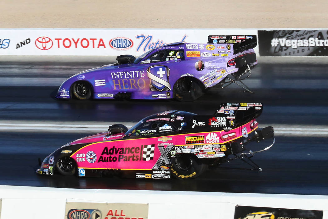 NHRA Funny Car Drivers Courtney Force, Left, And Jack Beckman Race During  The Third