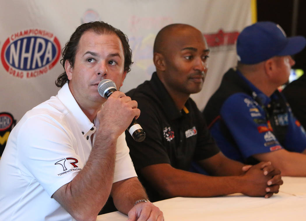 In this Thursday, Oct. 26, 2017, file photo, Steve Torrence, driver of the Capco Contractors / Torrence Racing dragster, speaks as Antron Brown, right, of the Match Tools / U.S. Army dragster, loo ...