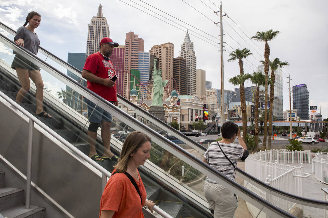 Visitors to the Las Vegas Strip descend on an escalator on Monday, July 17, 2017.  Patrick Connolly Las Vegas Review-Journal @PConnPie
