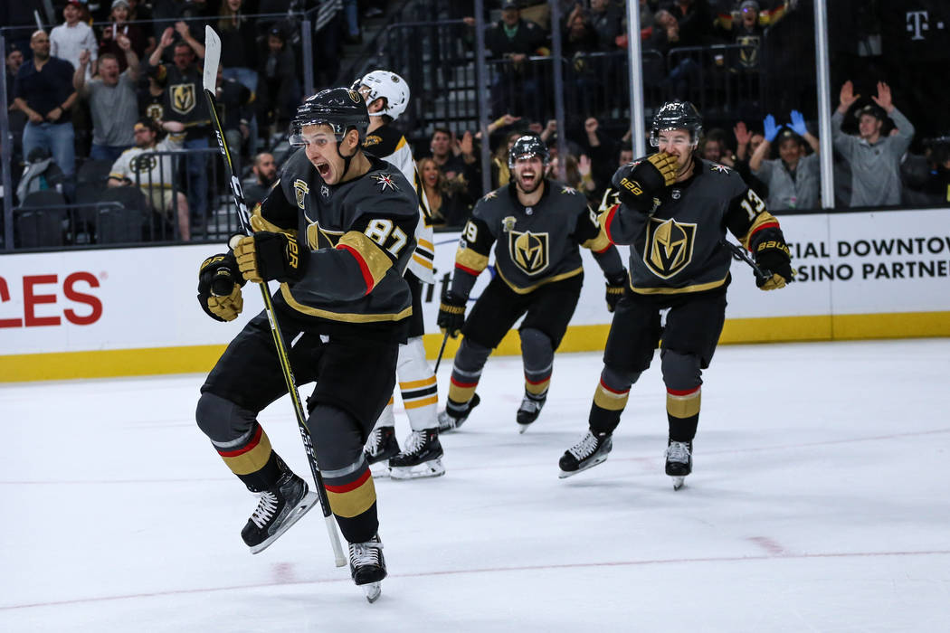 Vegas Golden Knights center Vadim Shipachyov (87), left, celebrates after scoring against the Boston Bruins during the second period of an NHL hockey game at T-Mobile Arena in Las Vegas, Sunday, O ...