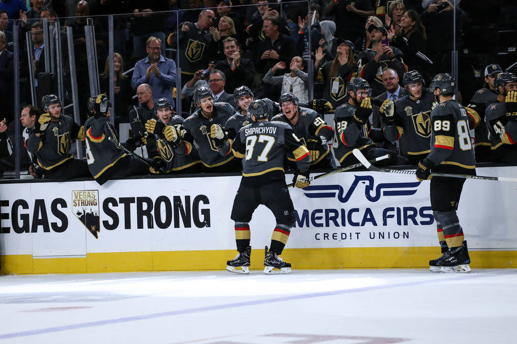 Vegas Golden Knights center Vadim Shipachyov (87), center, celebrates after scoring against the Boston Bruins during the second period of an NHL hockey game at T-Mobile Arena in Las Vegas, Sunday, ...