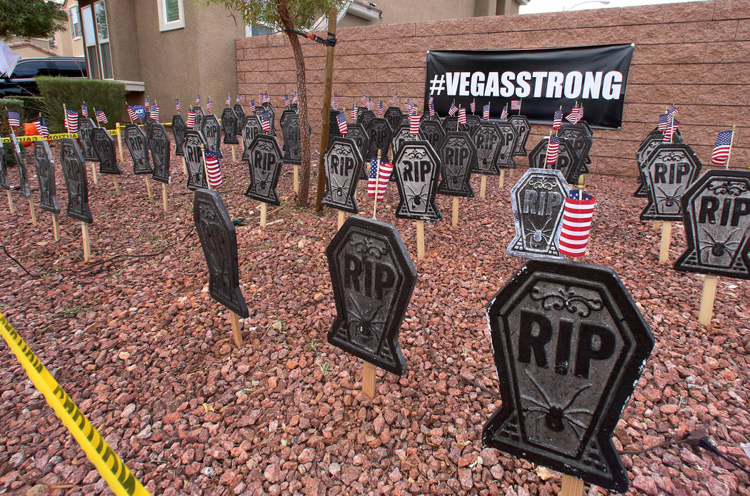 A Halloween display on Wednesday, Oct. 18, 2017 in a Las Vegas Valley neighborhood with 58 headstones, one for each of the victims of the Route 91 Harvest Festival shooting. Bizuayehu Tesfaye Las  ...