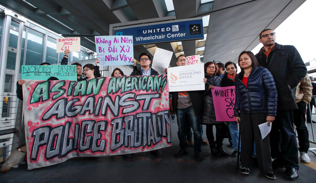 Community members protest the treatment of Dr. David Dao, who was forcibly removed from a United Airlines flight by the Chicago Aviation Police, at O'Hare International Airport in Chicago, Illinoi ...