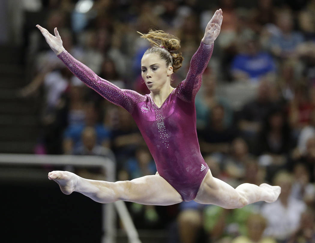 FILE - In this July 1, 2012, file photo, McKayla Maroney performs in the floor exercise event during the final round of the women's Olympic gymnastics trials in San Jose, Calif. Two-time Olympic m ...