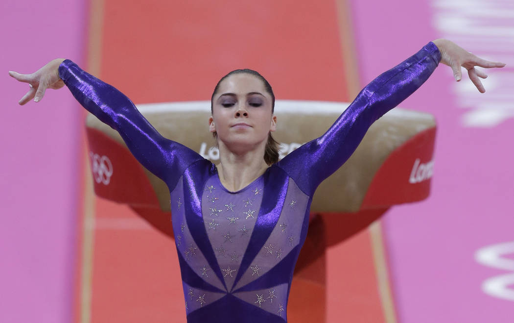 FILE - In this  July 29, 2012, file photo, U.S. gymnast McKayla Maroney poses after completing her routine on the vault during the Artistic Gymnastic women's qualifications at the 2012 Summer Olym ...