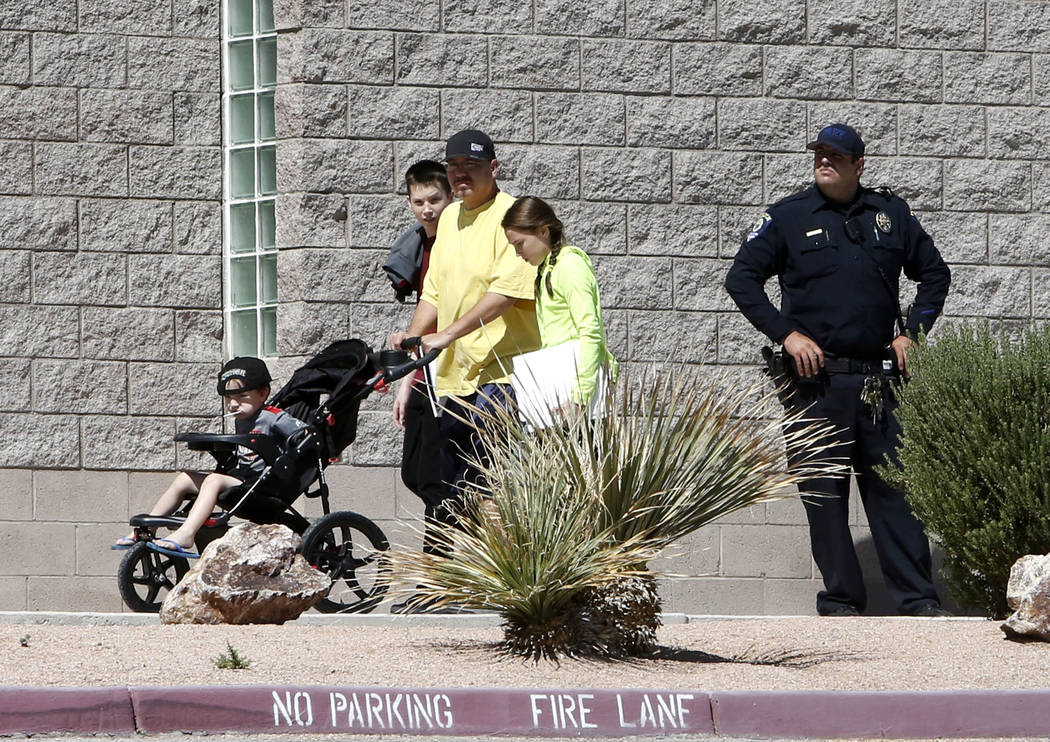 Blake Jupin, left, and his sister Holly are picked up from Thurman White Middle School by their stepfather John Wong after a student was stabbed on Friday, Aug. 18, 2017, in Henderson. (Bizuayehu  ...
