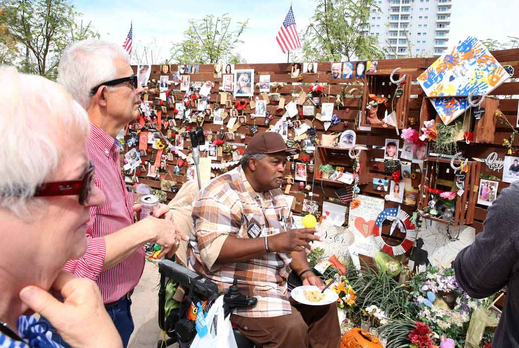 Andre King, center, center, talks about the healing garden as Shirley Weiskirchen, left, and her husband James, both from Omaha, Nbe., look on Wednesday, Oct. 18, 2017, in Las Vegas. King has been ...