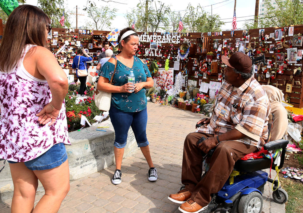 Andre King, right, talks to Becky Pike, center, at the healing garden Wednesday, Oct. 18, 2017, in Las Vegas. King has been spending 8-10 hours a day since the garden was completed. Bizuayehu Tesf ...