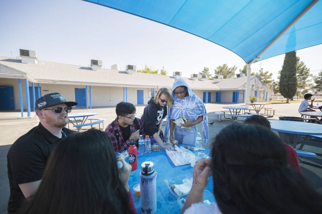Mission High School students and faculty talk and eat during lunch in the school's courtyard, Thursday, Oct.19, 2017. Mission High School is the districtճ first school dedicated solely to he ...