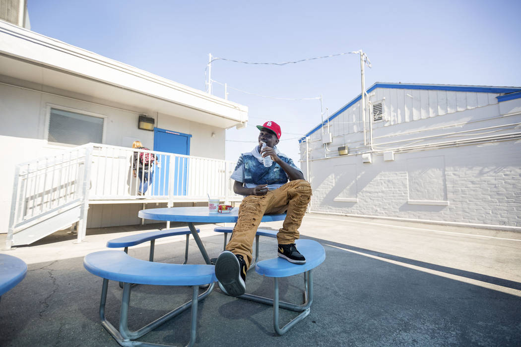 A Mission High School student Roosevelt Brown, 17, eats during lunch in the school's courtyard, in Las Vegas, Thursday, Oct.19, 2017. Mission High School is the districtճ first school dedica ...