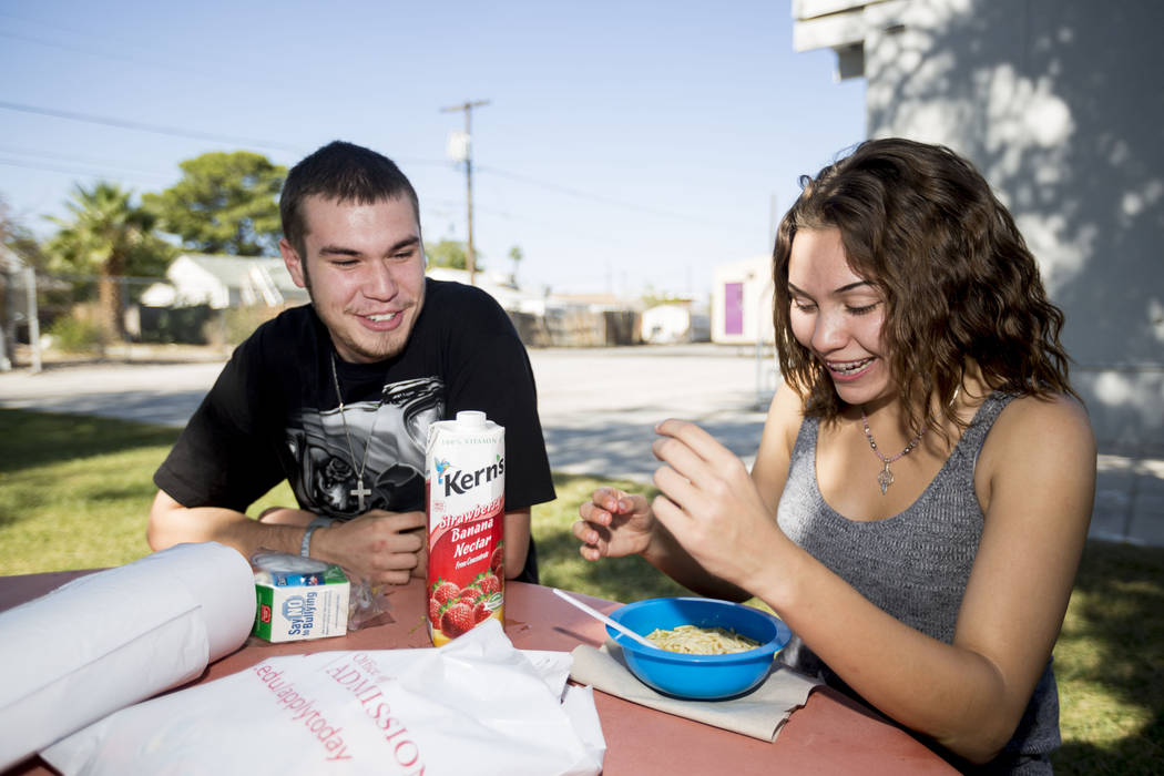 Mission High School students Dylan Bronder, 19, left, and Laura Johnson, 17, eat during lunch in the school's courtyard, in Las Vegas, Thursday, Oct.19, 2017. Mission High School is the district&# ...
