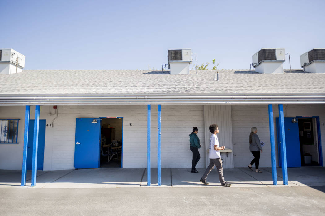 Students and faculty walk to the counselors office at Mission High School in Las Vegas, Thursday, Oct. 19, 2017. Mission High School is the districtճ first school dedicated solely to helping ...