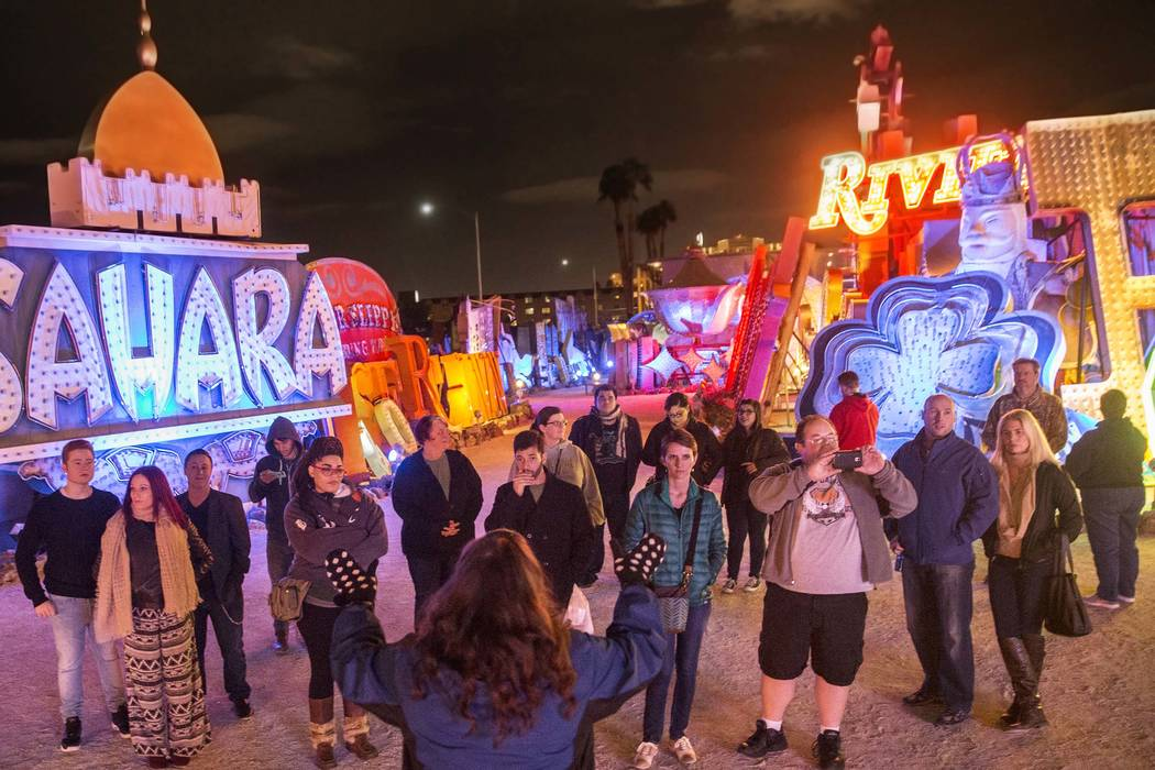 Ashley Canelon, middle, takes questions at the conclusion of a Neon Boneyard tour on Wednesday, Jan. 18, 2017, at the Neon Museum, in Las Vegas. (Benjamin Hager/Las Vegas Review-Journal)