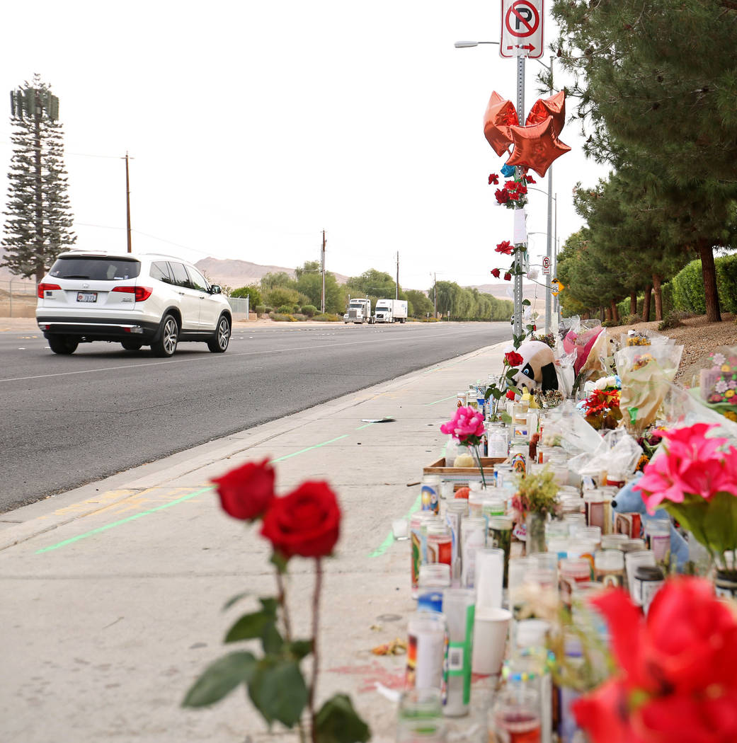 A car passes a memorial site on Wednesday, Oct. 18, 2017 where three juveniles between the ages of 12 and 15 were hit by a car on Desert Inn Road and east of Nellis Boulevard in Las Vegas. Elizabe ...