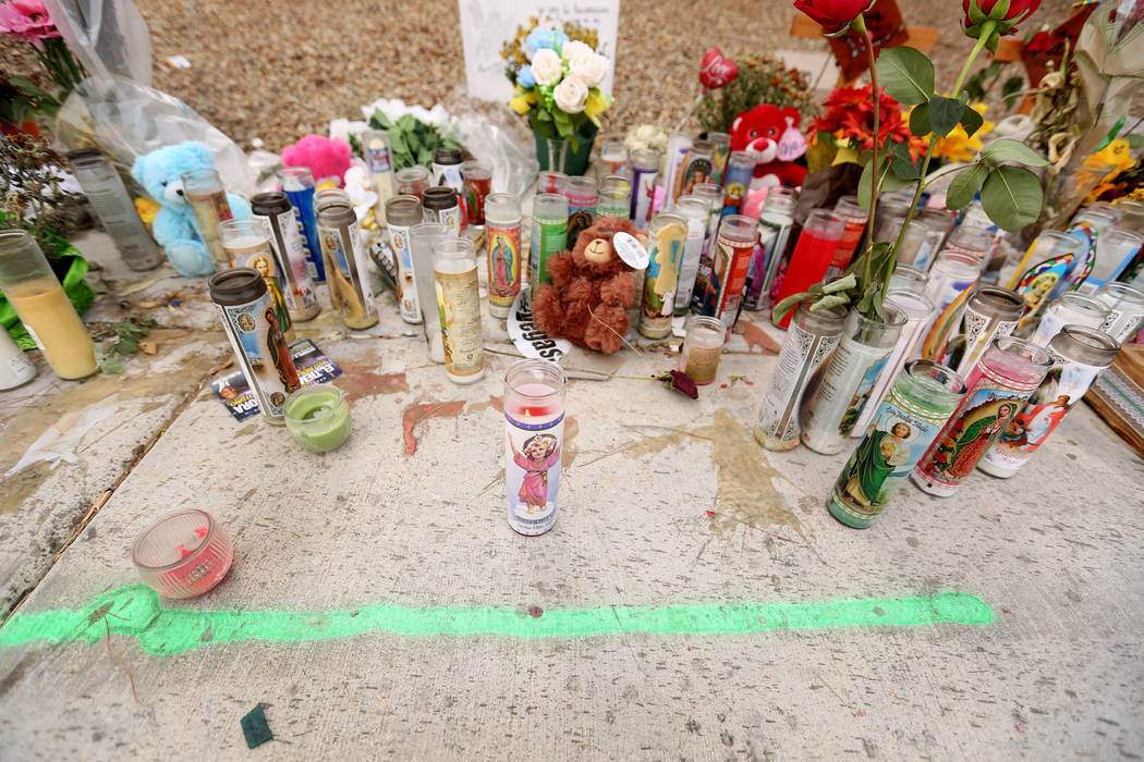 Cars pass a memorial site Oct. 18, 2017 where three juveniles between the ages of 12 and 15 were hit by a car on Desert Inn Road and east of Nellis Boulevard in Las Vegas. Elizabeth Brumley Las Ve ...
