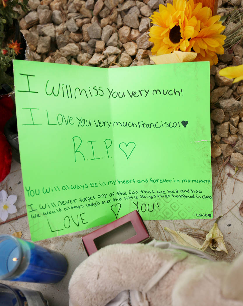 A note is left at a memorial site on Wednesday, Oct. 18, 2017 where three juveniles between the ages of 12 and 15 were hit by a car on Desert Inn Road and east of Nellis Boulevard in Las Vegas. El ...