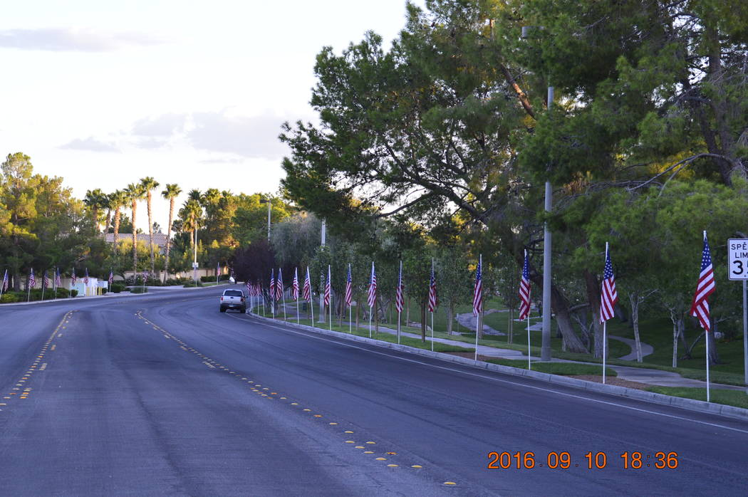 Flags line Apple Way in this photo taken soon after 9-11. Boys Scouts Troop 425 will do a similar project to coincide with the six trees being dedicated Nov. 4, 2017. (Peccole Ranch/Special)