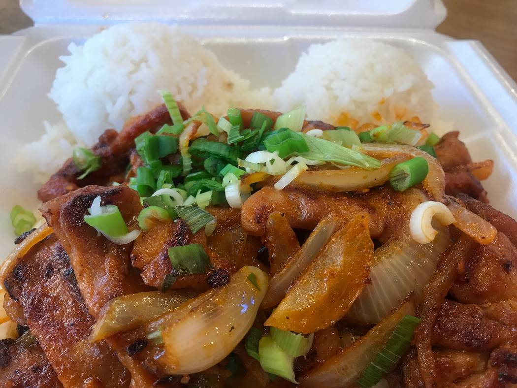 A spicy chicken plate is served with rice on Oct. 17, 2017 at Tiki's Hawaiian BBQ, 8460 W. Farm Road. (Kailyn Brown/View) @KailynHype