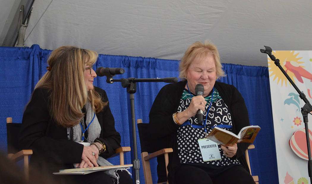 "Judy Schacher, left, listens as Lin Oliver reads from the Fantastic Frame book ""Danger! Tiger Crossing"" at the Las Vegas Book Festival in downtown Las Vegas on Saturday.  (Ginger Meurer/Special to ..."