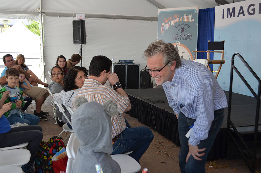 Ridley Pearson works the crowd at the Las Vegas Book Festival in downtown Las Vegas on Saturday. (Ginger Meurer/Special to Las Vegas Review-Journal)