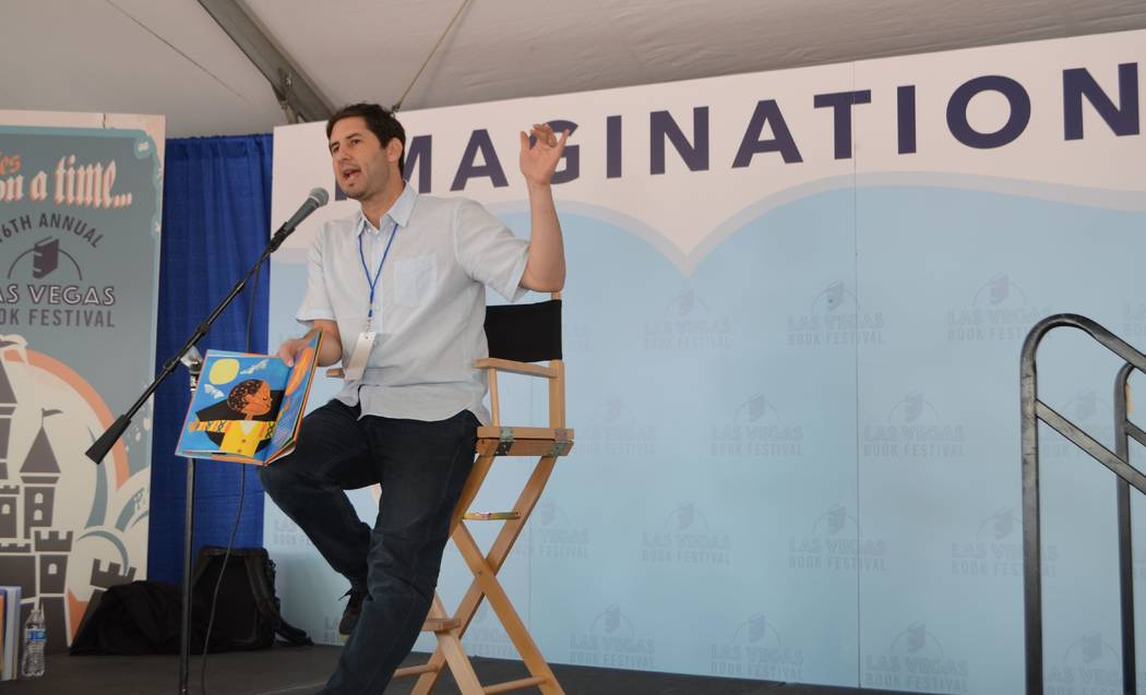 "Matt de la Peña reads from his Newbery Award-winning book ""Last Stop on Market Street"" at the Las Vegas Book Festival in downtown Las Vegas on Saturday. (Ginger Meurer/Special to Las Vegas Review ..."