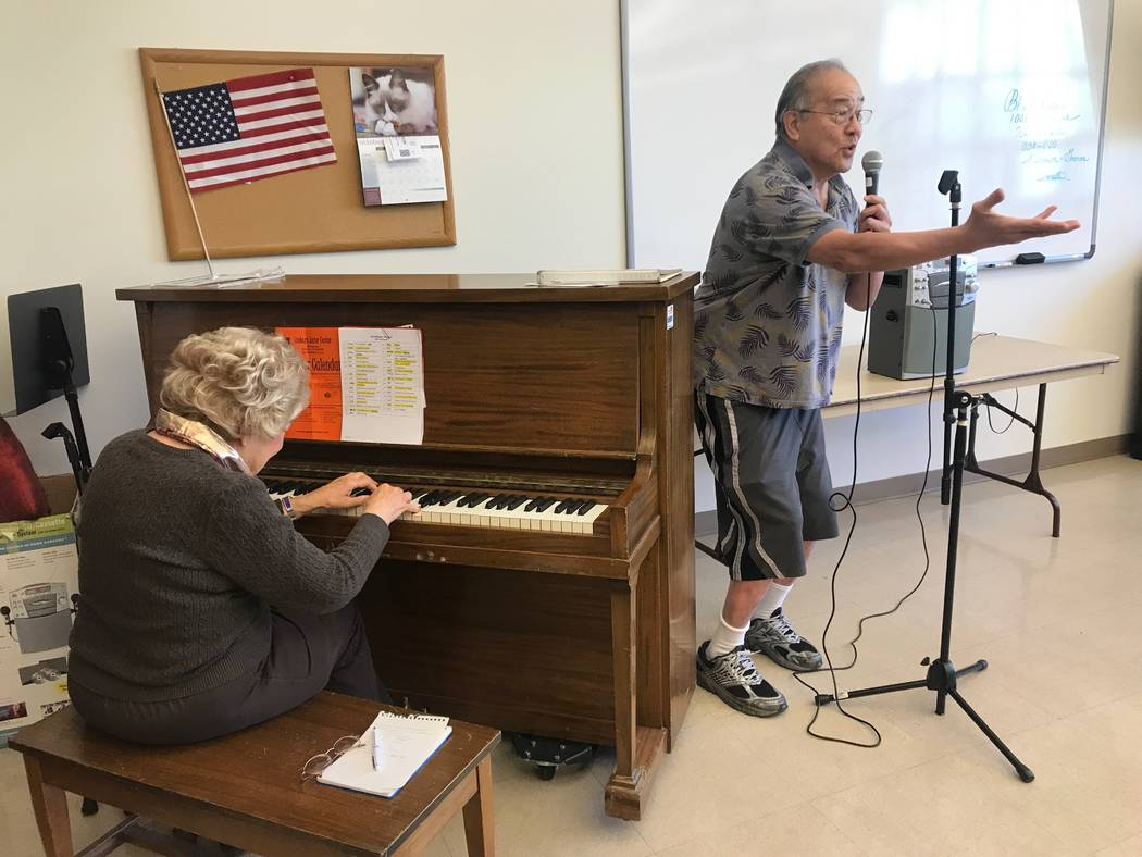 Good Times member Roland Tamsing leads a solo as director and pianist Rose Hyatt plays the piano during a rehearsal on Oct. 13, 2017 at the Howard Lieburn Senior Center, 6230 Garwood Ave. (Kailyn  ...
