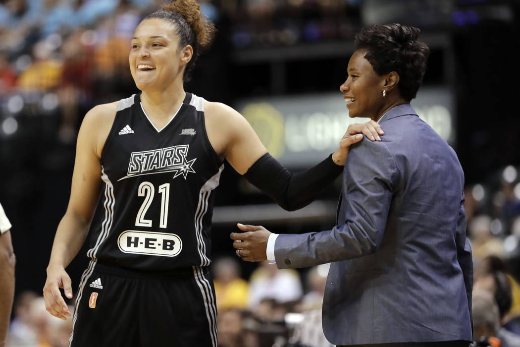San Antonio Stars' Kayla McBride laughs with head coach Vickie Johnson during the second half of a WNBA basketball game against the Indiana Fever in Indianapolis in July. (AP Photo/Darron Cummings ...