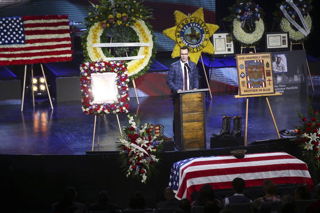Pastor Jud Wilhite speaks during a funeral for Las Vegas police officer Charleston Hartfield, Friday, Oct. 20, 2017, in Henderson, Nev. Hartfield was killed by a gunman shooting from a hotel into  ...