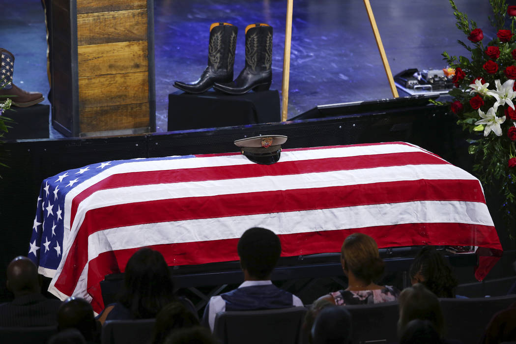 Family members listen during a funeral for Las Vegas police officer Charleston Hartfield, Friday, Oct. 20, 2017, in Henderson, Nev. Hartfield was killed by a gunman shooting from a hotel into a cr ...