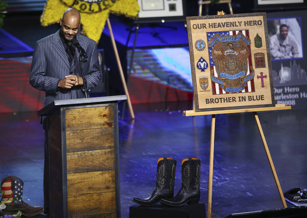 Carl Hartfield Jr. speaks during a funeral for his brother Las Vegas police officer Charleston Hartfield, Friday, Oct. 20, 2017, in Henderson, Nev. Hartfield was killed by a gunman shooting from a ...