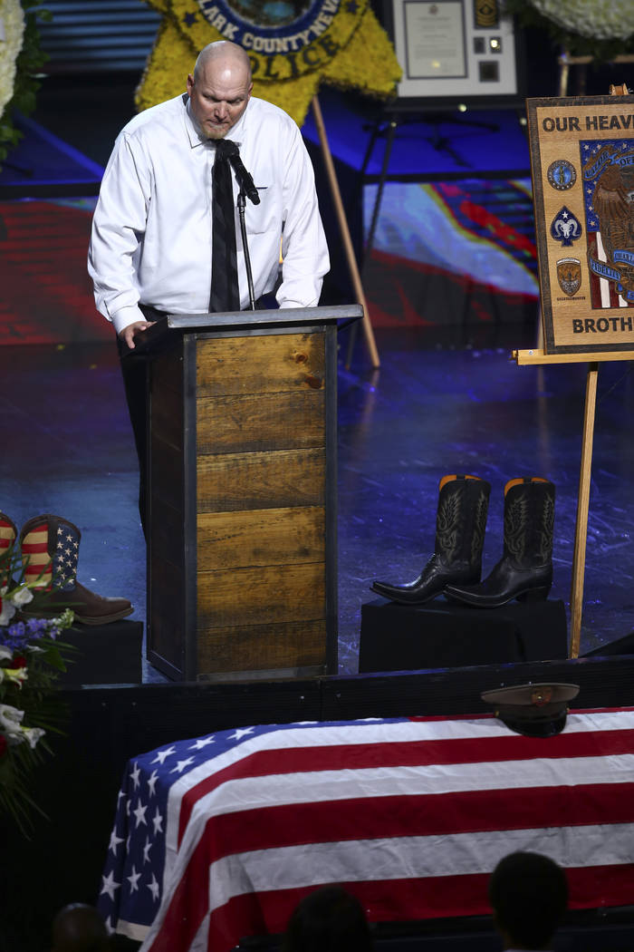 Chris Stockton speaks during a funeral for Las Vegas police officer Charleston Hartfield, Friday, Oct. 20, 2017, in Henderson, Nev. Hartfield was killed by a gunman shooting from a hotel into a cr ...
