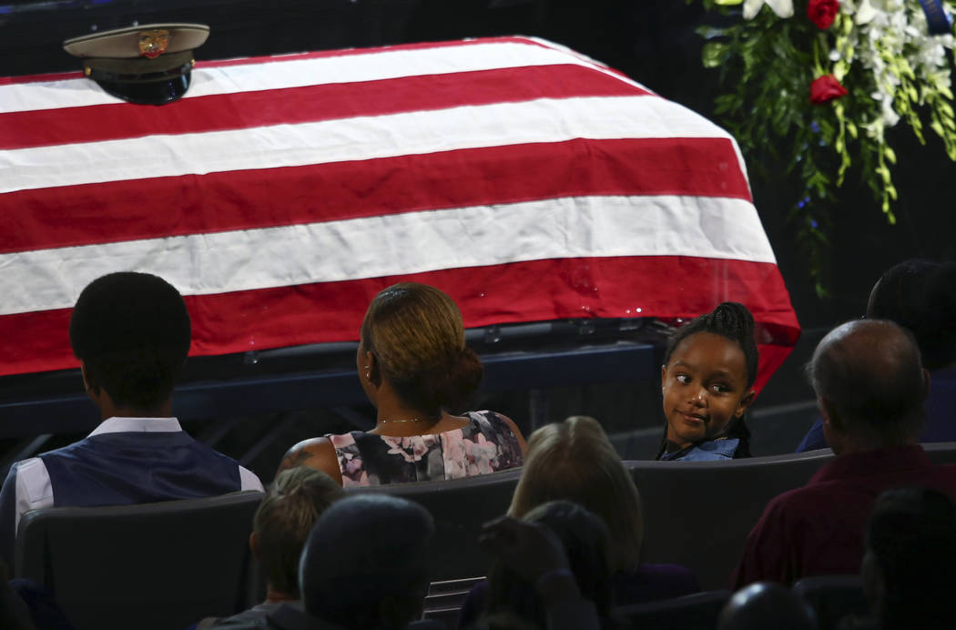 Savannah Hartfield, right, looks back at the audience during a funeral for her father Las Vegas police officer Charleston Hartfield, Friday, Oct. 20, 2017, in Henderson, Nev. Hartfield was killed  ...