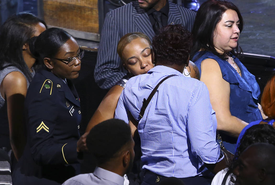 Veronica Hartfield, center, is hugged during a funeral for her husband Las Vegas police officer Charleston Hartfield, Friday, Oct. 20, 2017, in Henderson, Nev. Hartfield was killed by a gunman sho ...