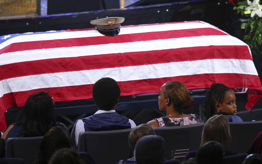 Family members including daughter Savannah Hartfield, right, listen during a funeral for Las Vegas police officer Charleston Hartfield, Friday, Oct. 20, 2017, in Henderson, Nev. Hartfield was kill ...