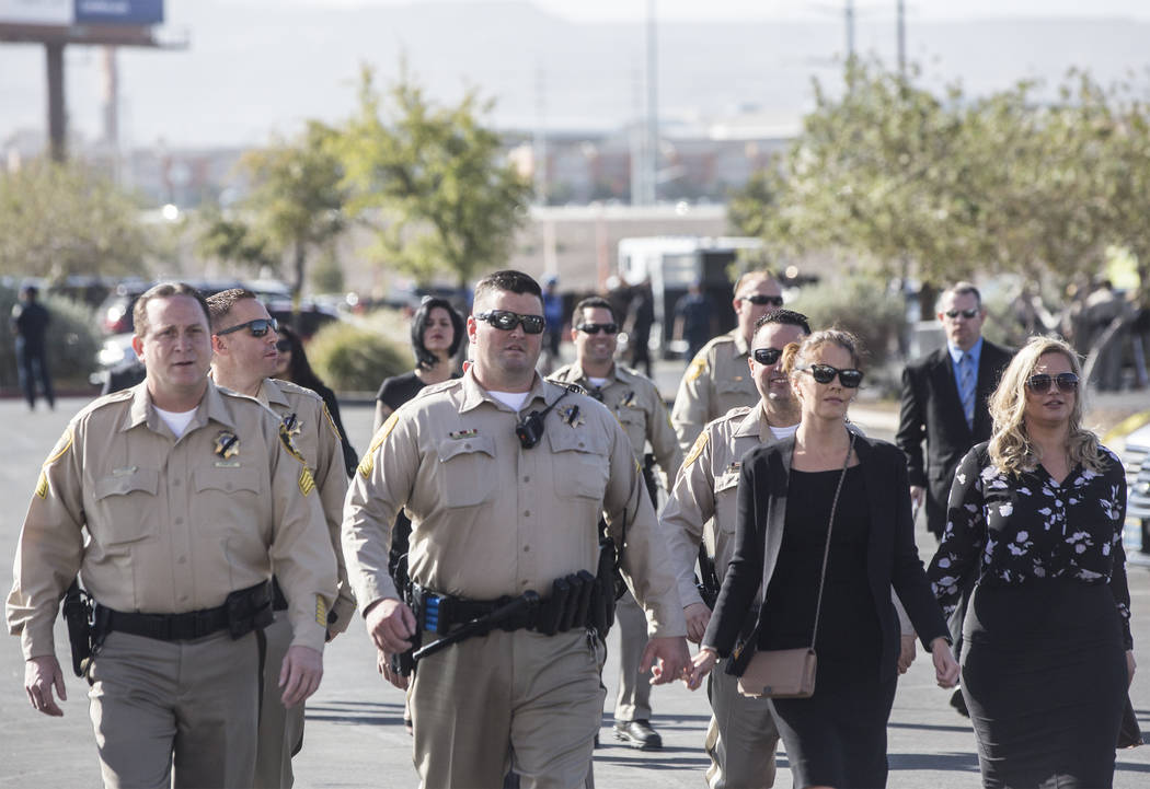 Metro officers walk towards Central Church for the service for Charleston Hartfield, the off-duty officer killed during the Route 91 shooting on Friday, October, 20, 2017, in Henderson. Benjamin H ...