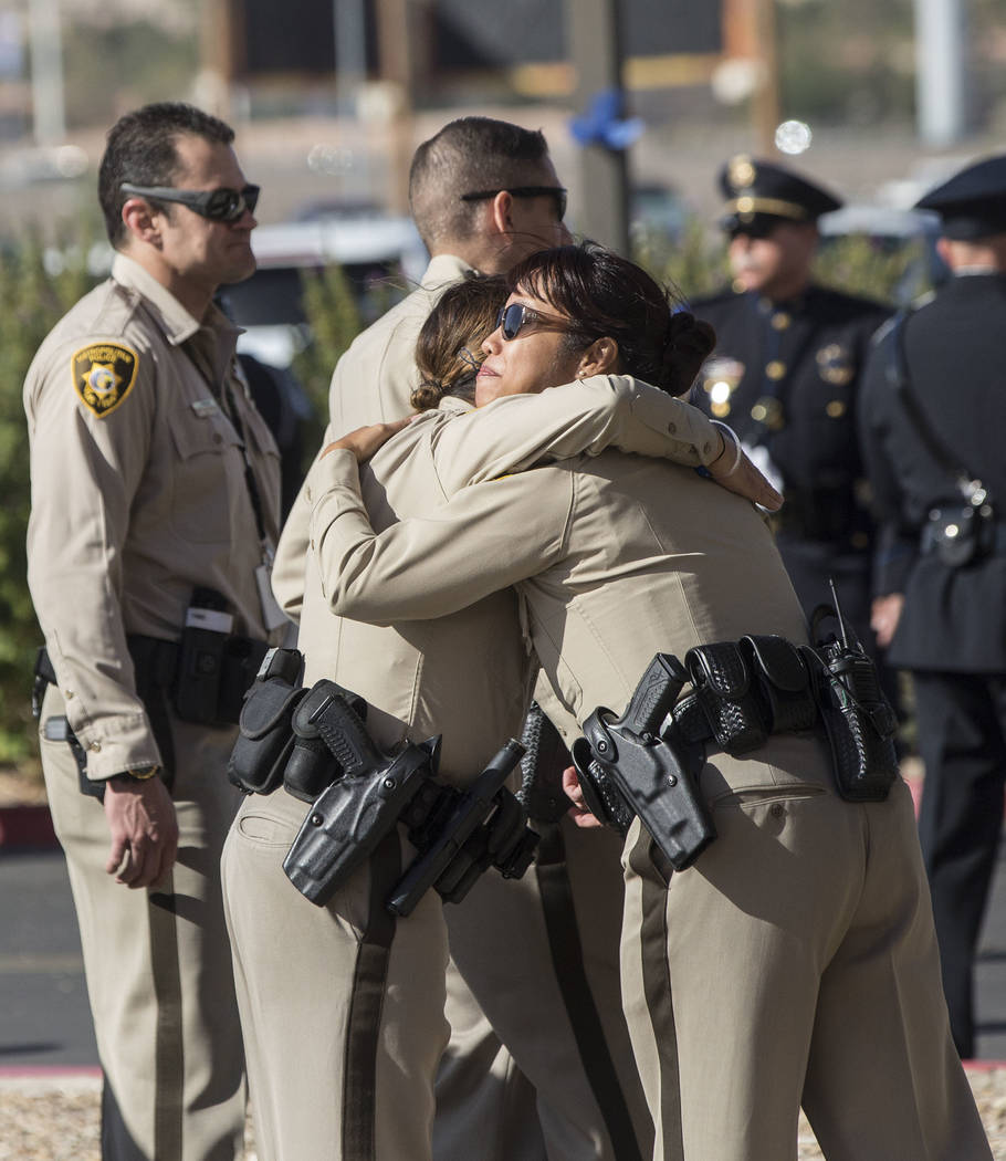 Metro officers comfort each other outside Central Church before the start of the service for Charleston Hartfield, the off-duty officer killed during the Route 91 shooting on Friday, October, 20,  ...