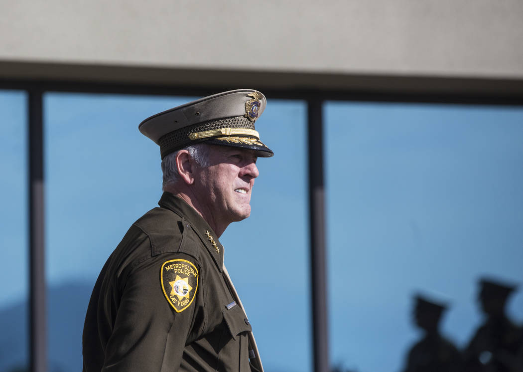 Sheriff Joe Lombardo waits outside of Central Church with fellow Metro officers for the funeral procession to arrive before the start of the service for Charleston Hartfield, the off-duty officer  ...