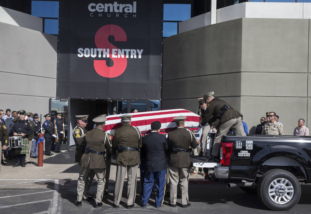 The body of Metro officer Charleston Hartfield is carried into Central Church during a service for the off-duty officer killed during the Route 91 shooting on Friday, October, 20, 2017, in Henders ...