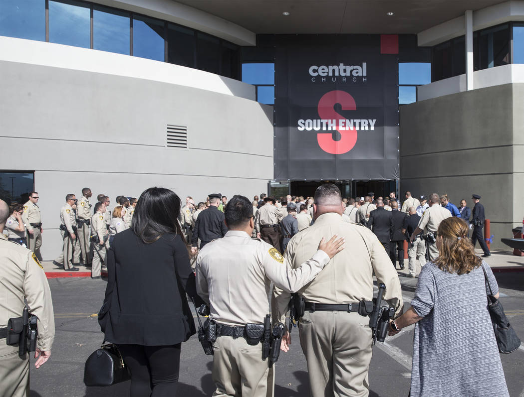 Metro officers walk into Central Church for the service for Charleston Hartfield, the off-duty officer killed during the Route 91 shooting on Friday, October, 20, 2017, in Henderson. Benjamin Hage ...