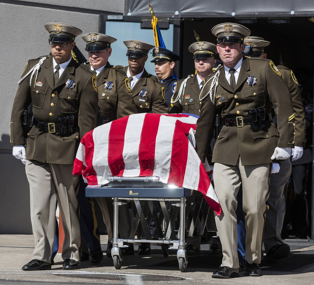 The body of Charleston Hartfield is carried out of Central Church by fellow Metro officers at the conclusion of the service for the off-duty officer killed during the Route 91 shooting on Friday,  ...