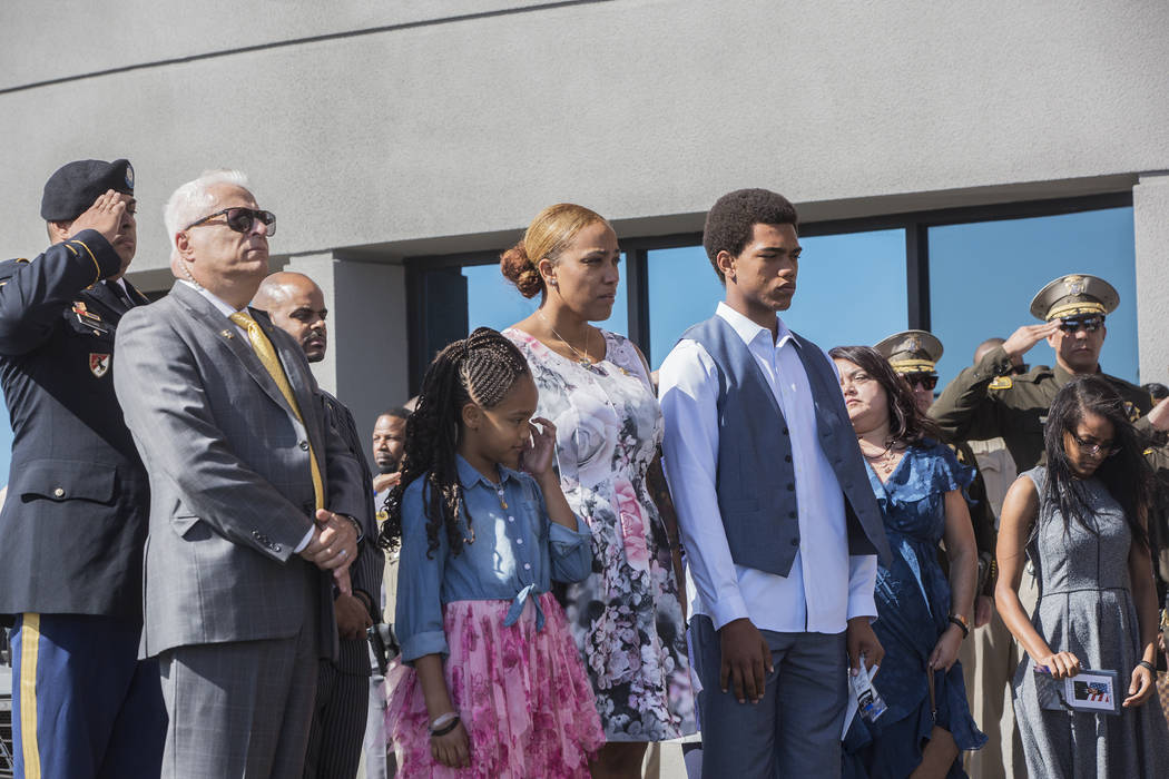 Charleston Hartfield's daughter Savannah, third from left,  widow Veronica and son Ayzayah watch the fallen officer's body be taken out of Central Church at the conclusion of the Route 91 shooting ...