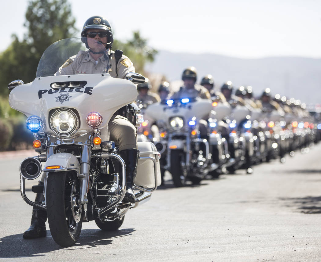 A motorcade of Metro officers prepare to transport the body of Charleston Hartfield at the conclusion of the service for the off-duty officer killed during the Route 91 shooting on Friday, October ...