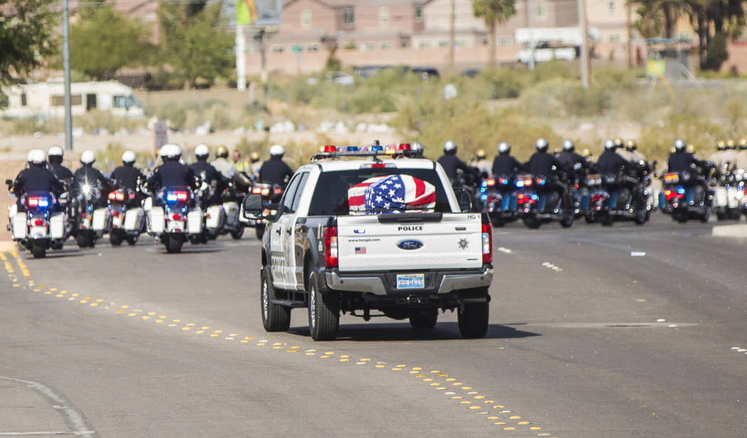 A motorcade of Metro officers transport the body of Charleston Hartfield at the conclusion of the service for the off-duty officer killed during the Route 91 shooting on Friday, October, 20, 2017, ...