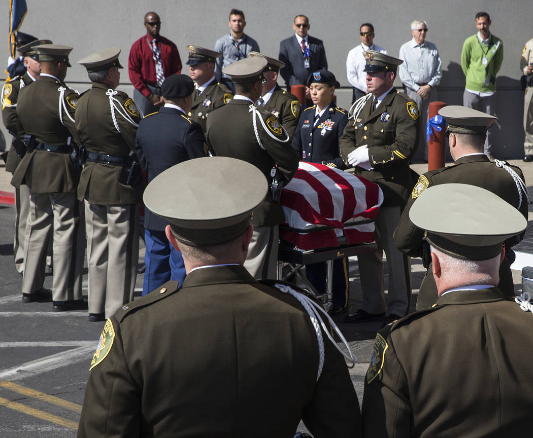 Metro officers prepare to transport the body of Charleston Hartfield at the conclusion of the service for the off-duty officer killed during the Route 91 shooting on Friday, October, 20, 2017, at  ...