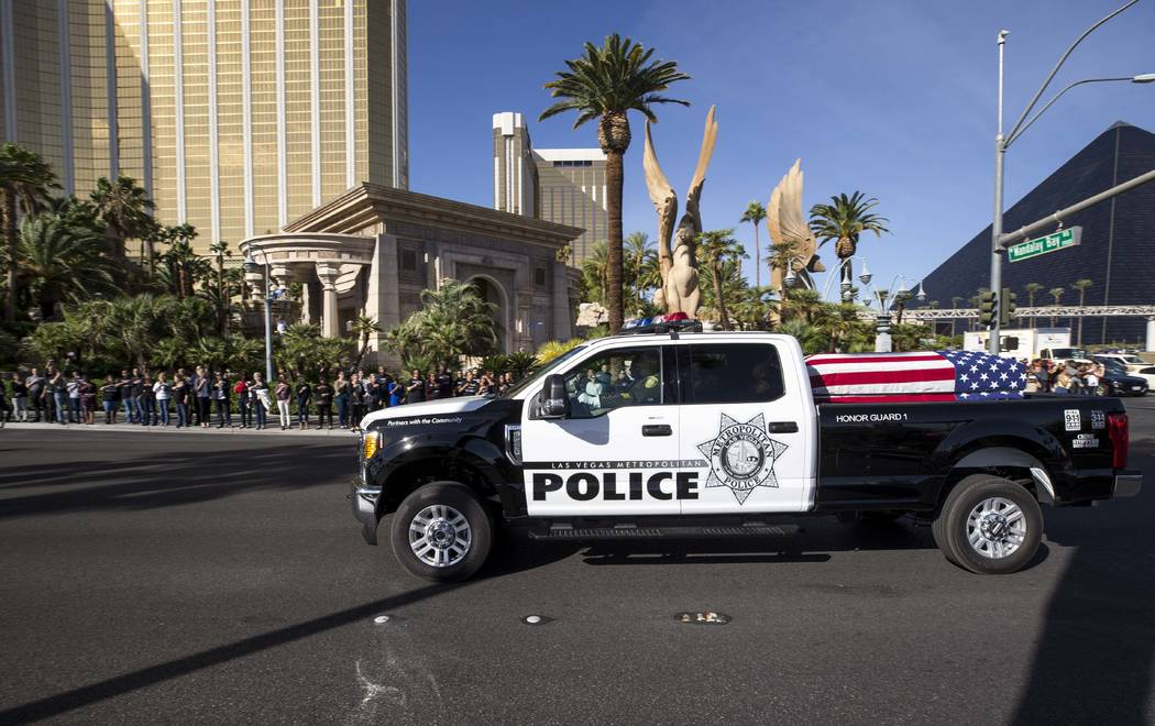 The procession for Metro officer Charleston Hartfield passes by Mandalay Bay en route to a memorial service on Friday, Oct. 20, 2017. Richard Brian Las Vegas Review-Journal @vegasphotograph