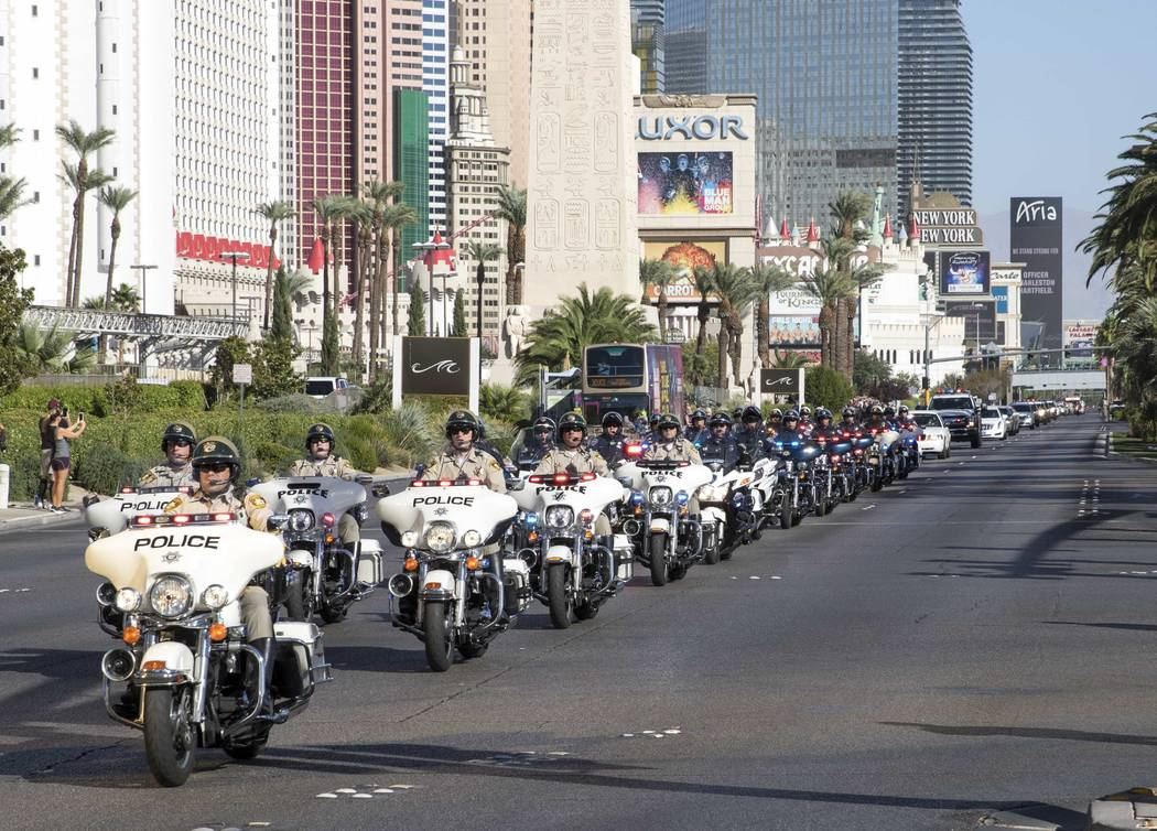 The procession for Metro officer Charleston Hartfield passes by the Luxor en route to a memorial service on Friday, Oct. 20, 2017. Richard Brian Las Vegas Review-Journal @vegasphotograph
